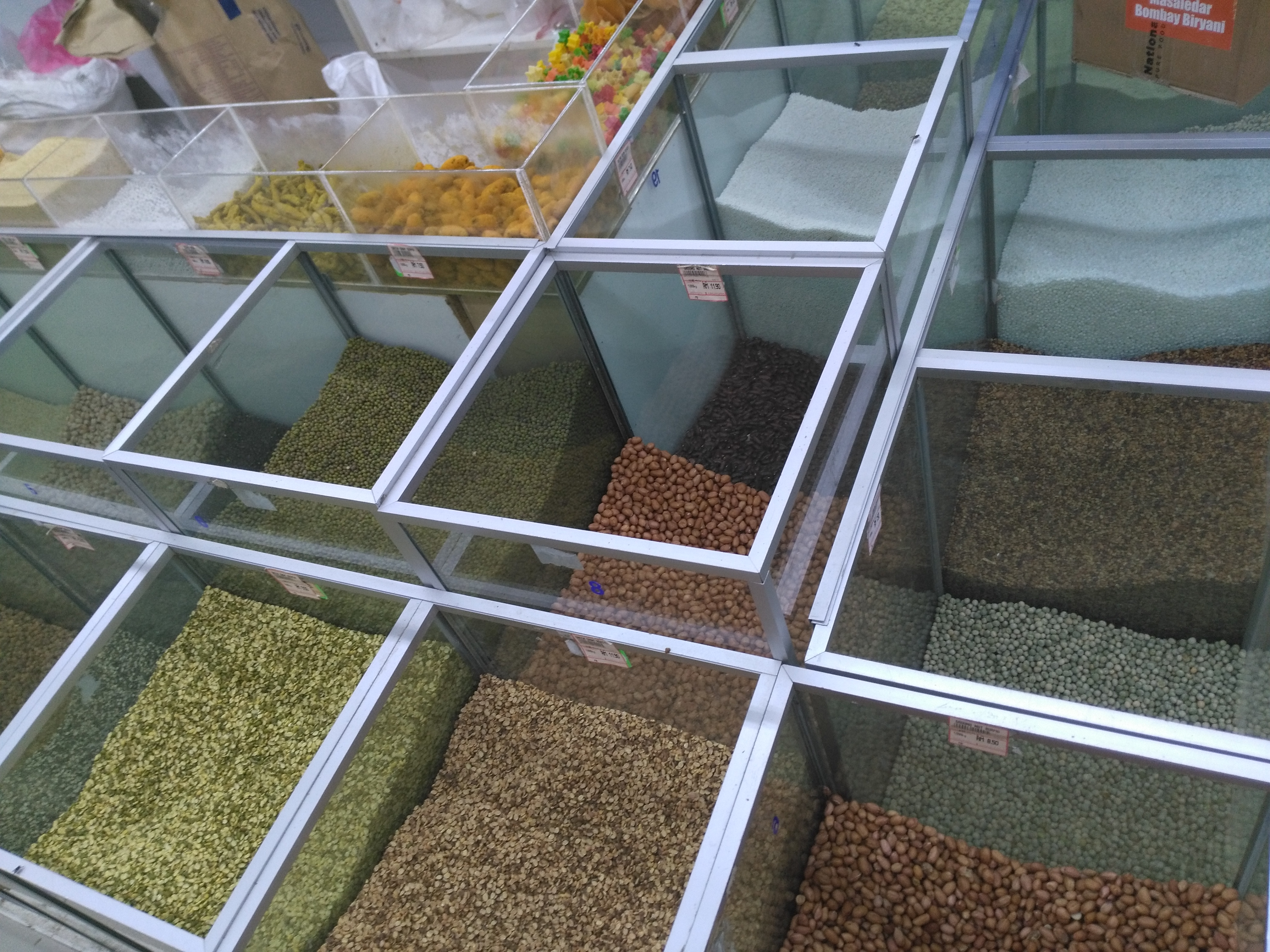 An assortment of beans and lentils at a market.