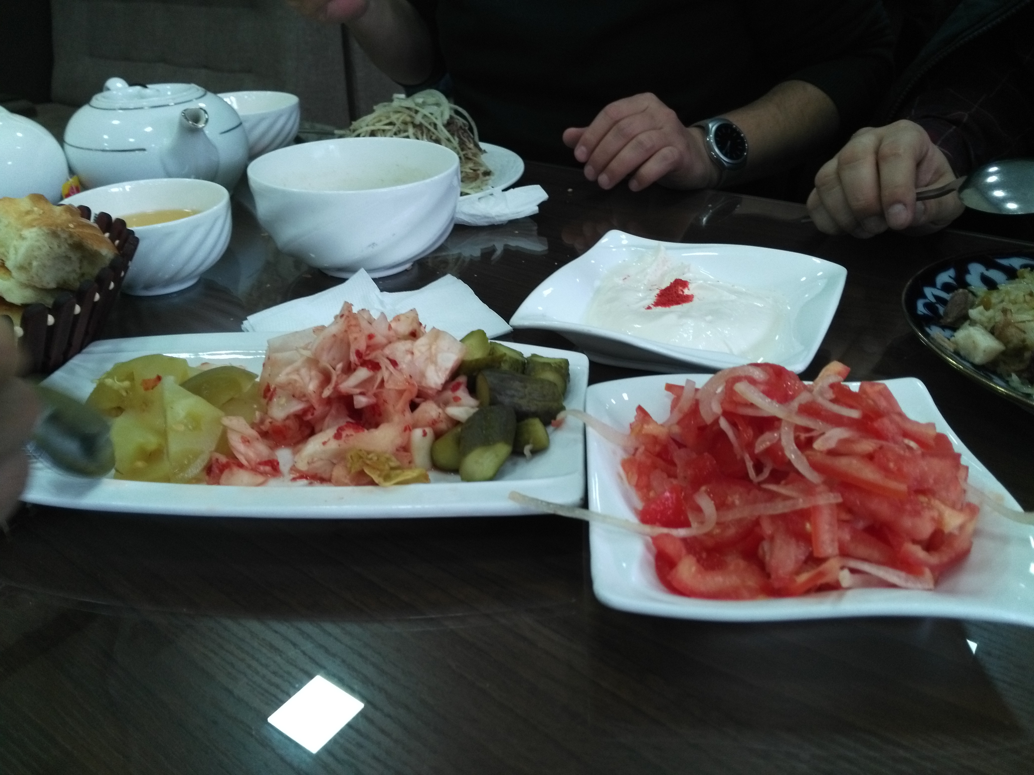 Achichu (tomato salad), tuzlama (pickle salad), suzman (yogurt dip), naryn (stringy thing in the top left).