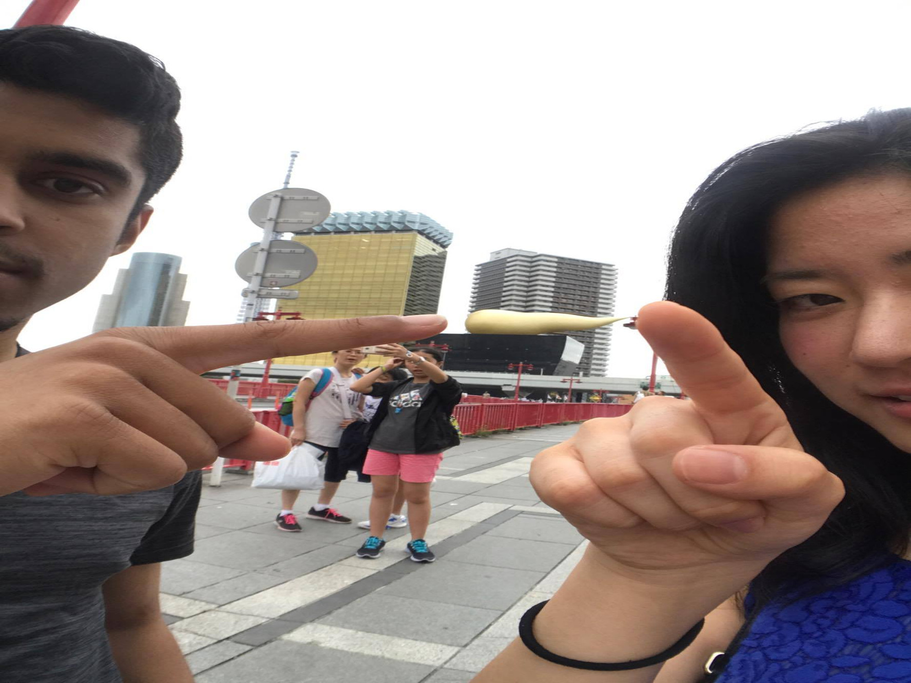 Kazuha and I pointing to what seems like a structure resembling the poop emoji.