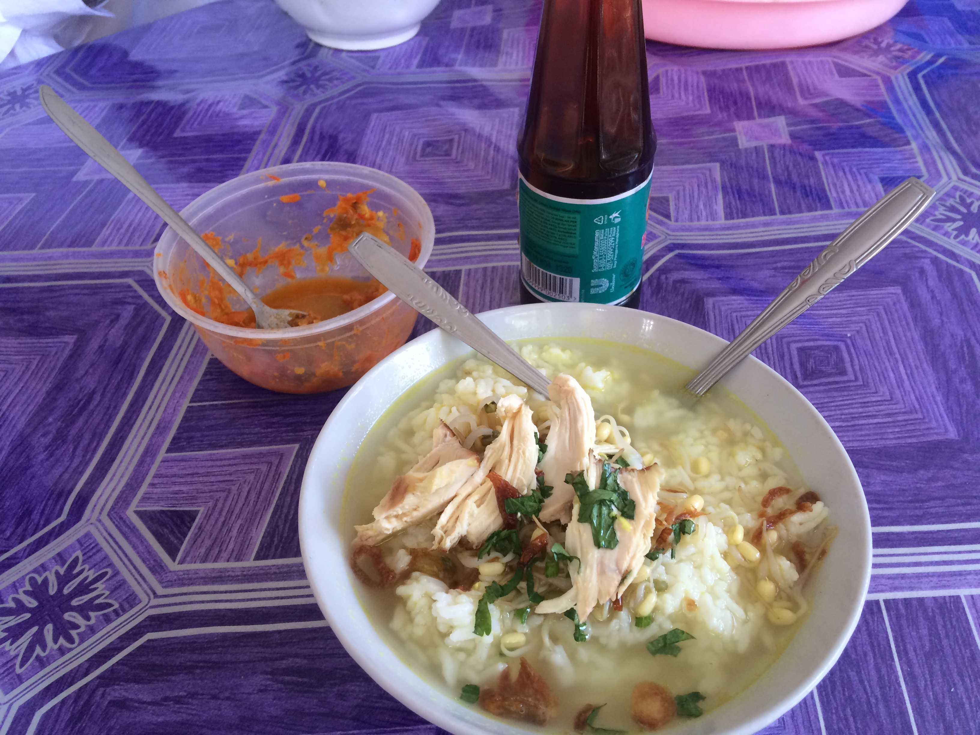 Soto Ayam: In solo, a hearty dish with rice, chicken strips, and chicken broth.