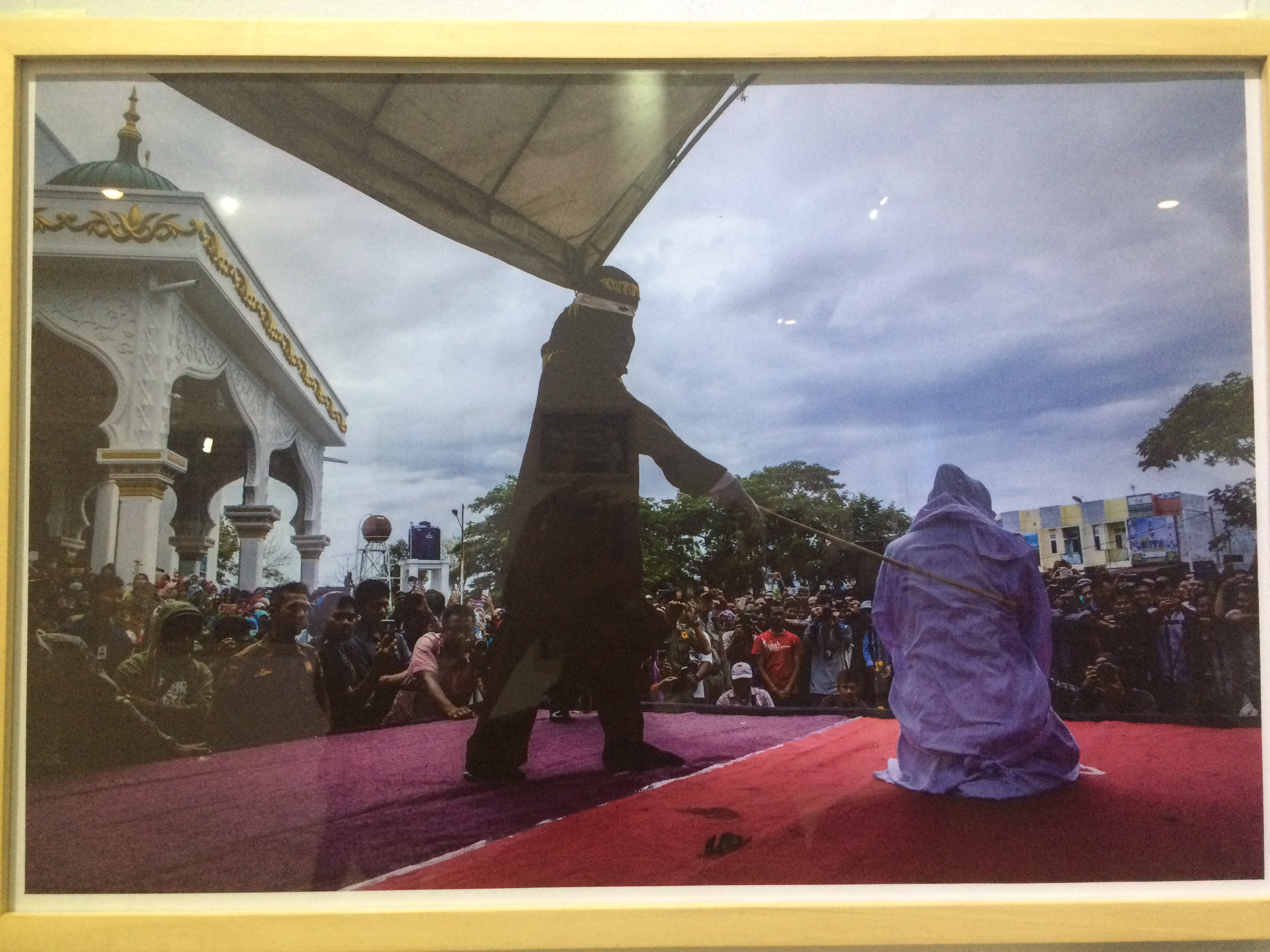 A photo from the exhibit portraying Sharia law at work in Aceh, Sumatra, Indonesia.