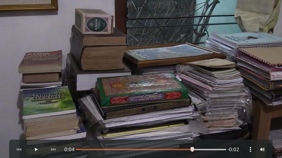 A small fragment of Pak Suhadi's book collection.